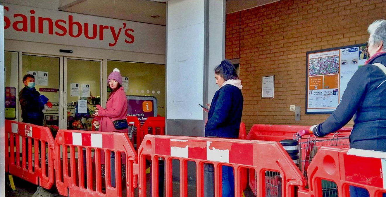 Social distancing queueing for the supermarket J. Sainsburys north London Coronavirus Covid 19 pandemic 30 March 2020